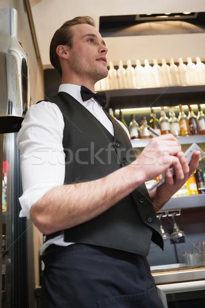 Cameriere fine notepad bar lavoro Foto d'archivio © wavebreak_media