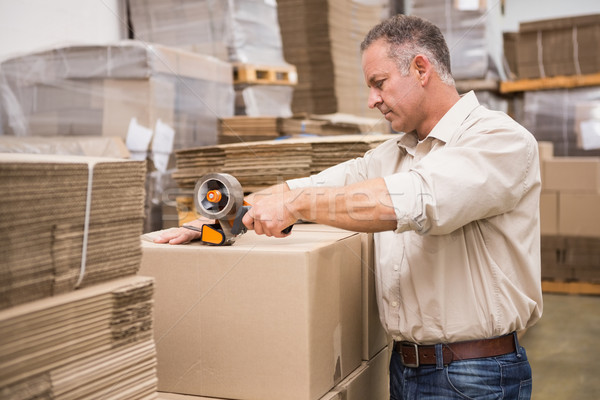 Warehouse worker preparing a shipment Stock photo © wavebreak_media