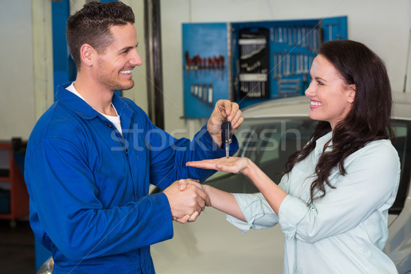 Mechanic giving keys to satisfied customer Stock photo © wavebreak_media