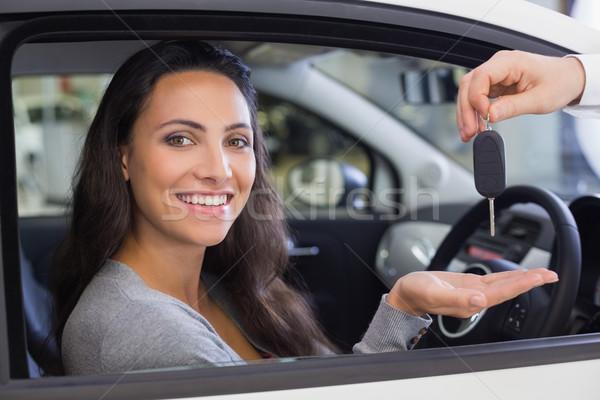 Salesman giving keys to a smiling woman Stock photo © wavebreak_media