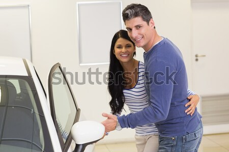 Smiling couple looking inside a car Stock photo © wavebreak_media