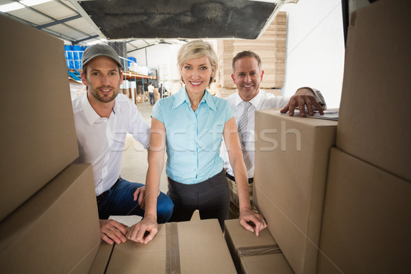 Portrait of managers smiling at camera behind the van Stock photo © wavebreak_media