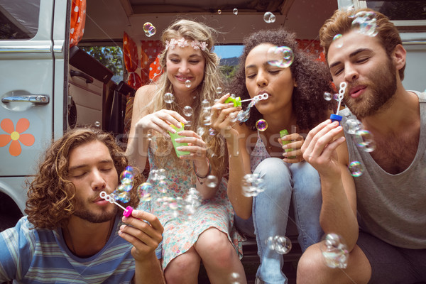 Hipsters blowing bubbles in camper van Stock photo © wavebreak_media