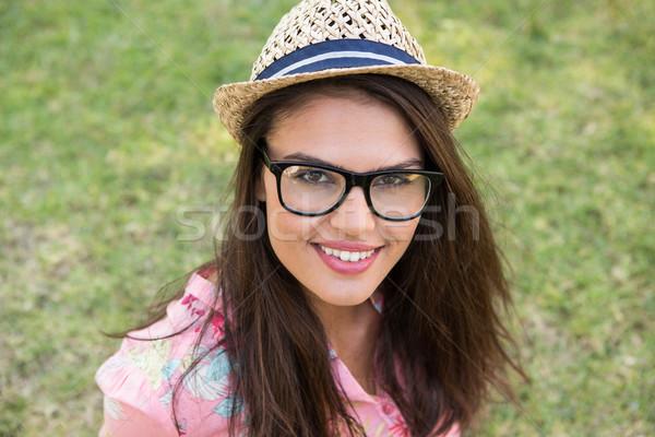 Pretty brunette smiling in park Stock photo © wavebreak_media