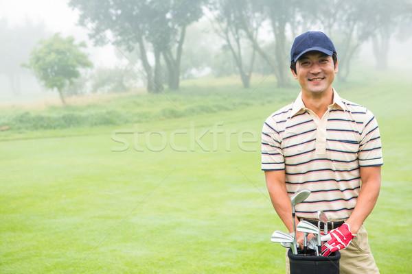 гольфист улыбаясь камеры сумка для гольфа Сток-фото © wavebreak_media