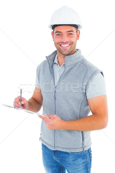 Retrato sorridente supervisor escrita clipboard branco Foto stock © wavebreak_media