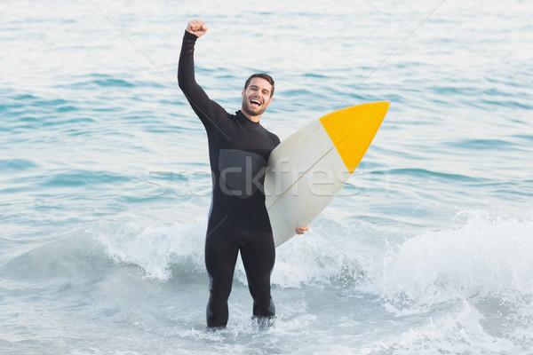 Uomo tavola da surf spiaggia sport mare Foto d'archivio © wavebreak_media