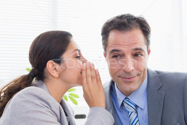 Femme d'affaires chuchotement quelque chose collègue bureau affaires Photo stock © wavebreak_media