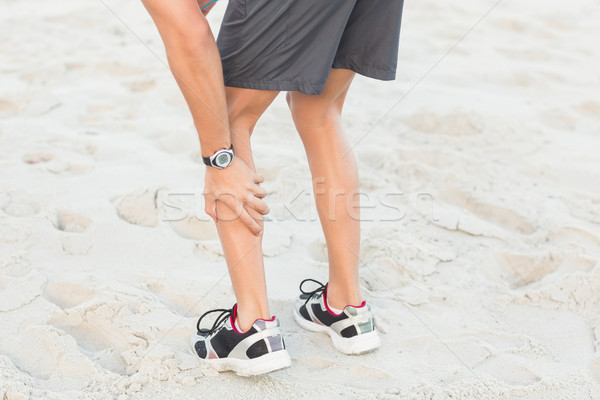 Montare uomo dolore muscolare spiaggia primavera fitness Foto d'archivio © wavebreak_media