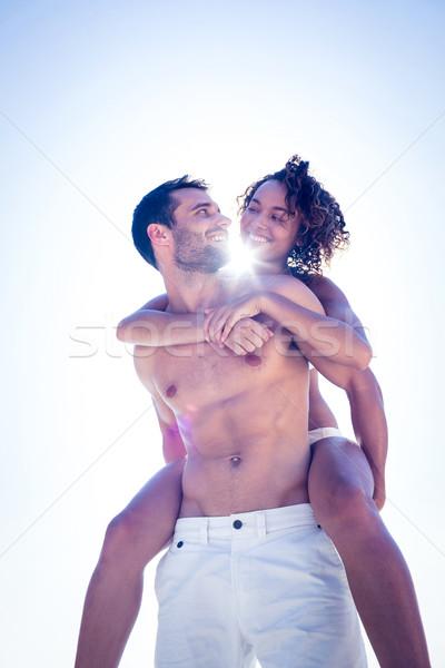 Boyfriend doing piggy-back to his girlfriend Stock photo © wavebreak_media