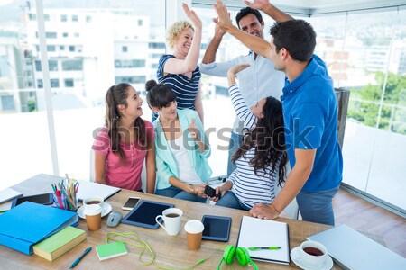 Creativo squadra di affari mani insieme ufficio donna Foto d'archivio © wavebreak_media