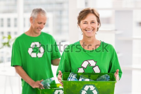 Blonde wearing a recycling tshirt holding recycle box Stock photo © wavebreak_media