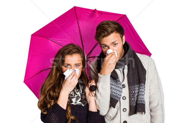 Couple blowing nose while holding umbrella Stock photo © wavebreak_media