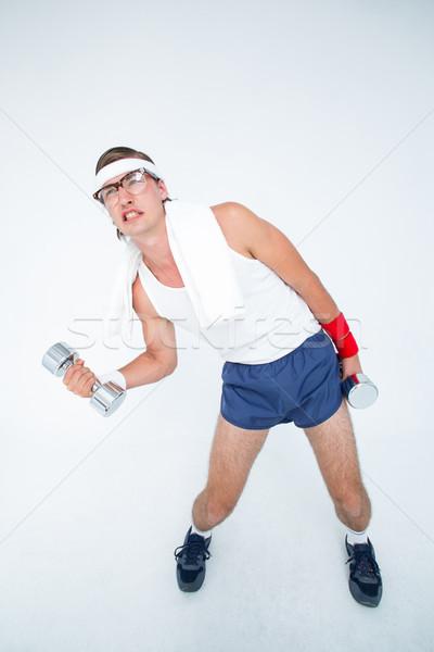 Hipszter emel súlyzók sportruha fehér fitnessz Stock fotó © wavebreak_media