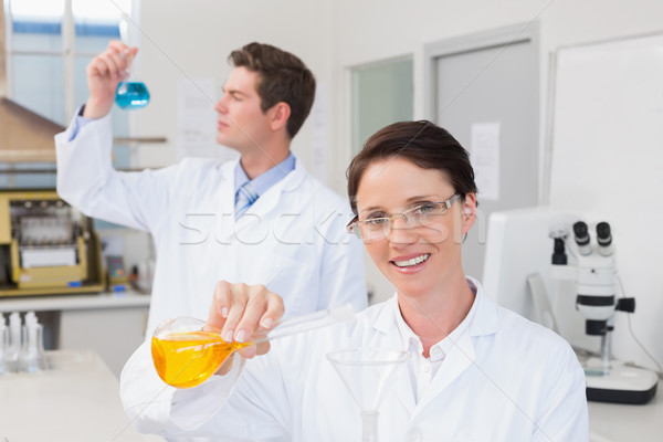 Scientists working attentively together with beakers Stock photo © wavebreak_media