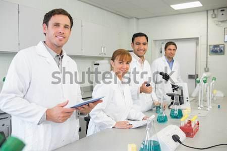 Feliz cientista sorridente câmera colegas trabalhando Foto stock © wavebreak_media
