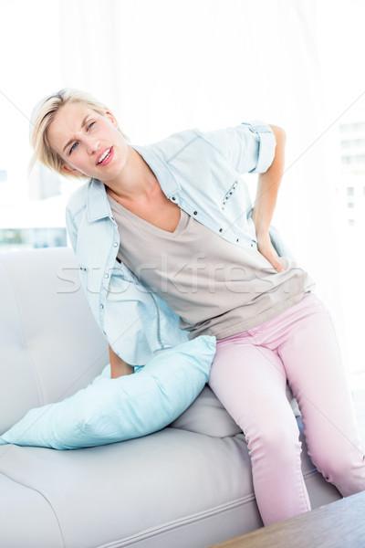 Ból w krzyżu salon domu sofa kobiet Zdjęcia stock © wavebreak_media