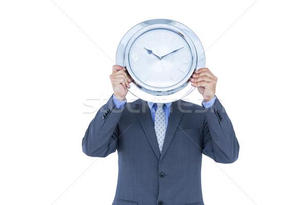 Empresário ocultação cara branco relógio camisas Foto stock © wavebreak_media