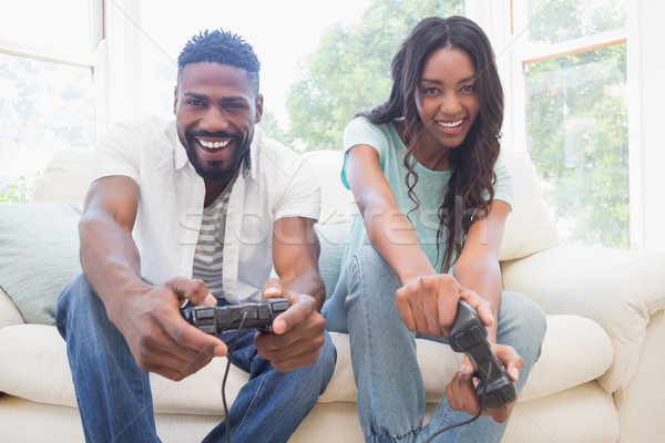 Happy couple on the couch playing video games Stock photo © wavebreak_media