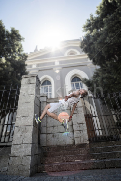 Extreme athlete doing a backflip in front of a building Stock photo © wavebreak_media