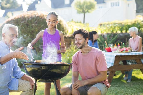 Apa nagyapa néz lány barbecue park Stock fotó © wavebreak_media