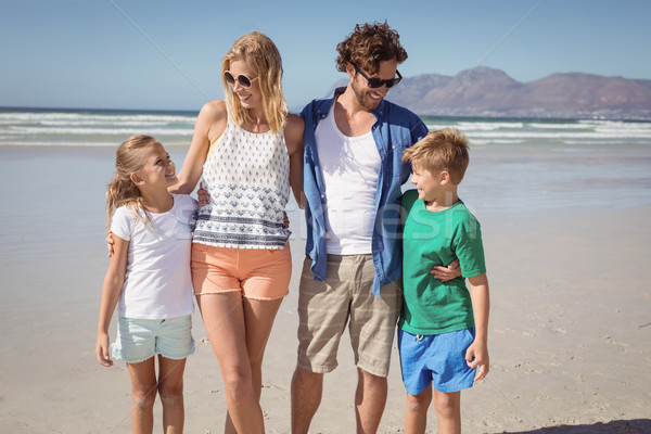 Happy family standing together at beach Stock photo © wavebreak_media