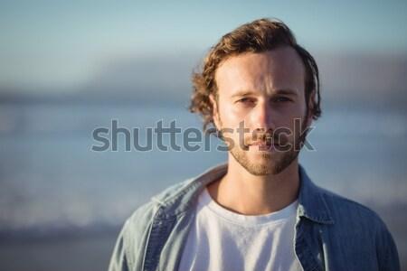 Portré fiatalember tengerpart égbolt szeretet férfi Stock fotó © wavebreak_media