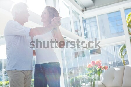 Smiling couple having champagne in balcony Stock photo © wavebreak_media
