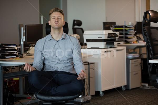 Executive meditating at desk Stock photo © wavebreak_media
