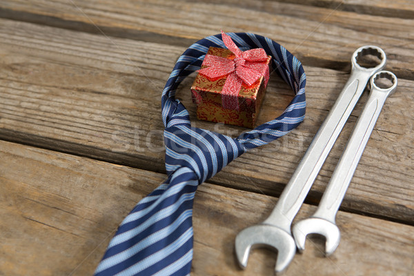 High angle view of gift box with necktie and work tools Stock photo © wavebreak_media