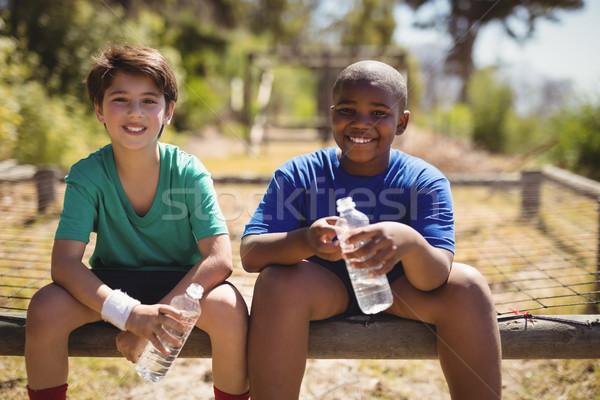 Retrato sonriendo amigos relajante entrenamiento Foto stock © wavebreak_media