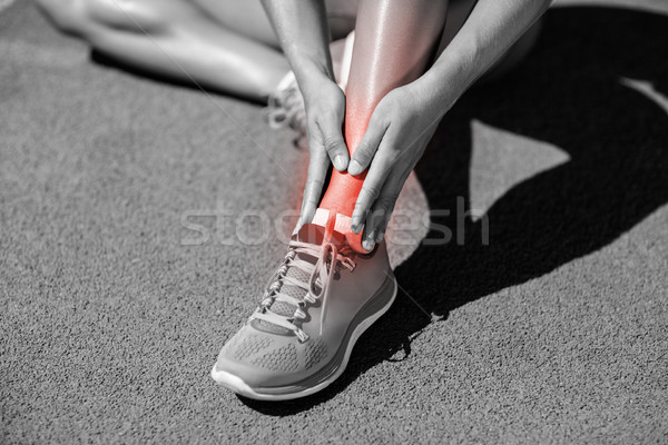 Low section of sportswoman suffering from joint pain on track Stock photo © wavebreak_media