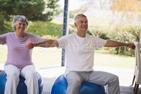 Sorridente casal de idosos juntos varanda sessão Foto stock © wavebreak_media