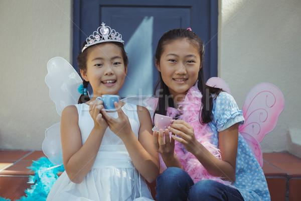 Siblings in fairy costume having a tea party Stock photo © wavebreak_media