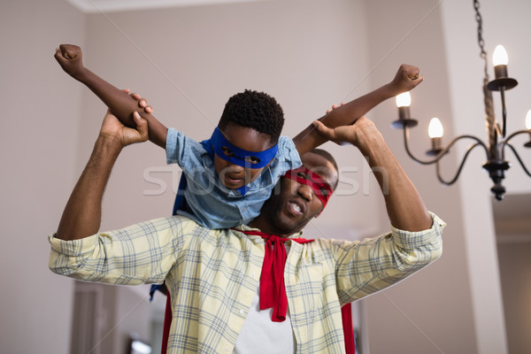 Father and son wearing superhero costume at home Stock photo © wavebreak_media