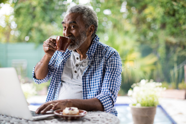 Senior man looking away while drinking coffee Stock photo © wavebreak_media