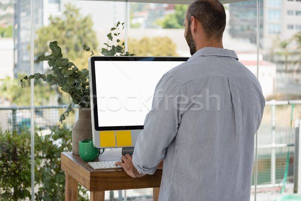 Rear view of designer using computer in office Stock photo © wavebreak_media