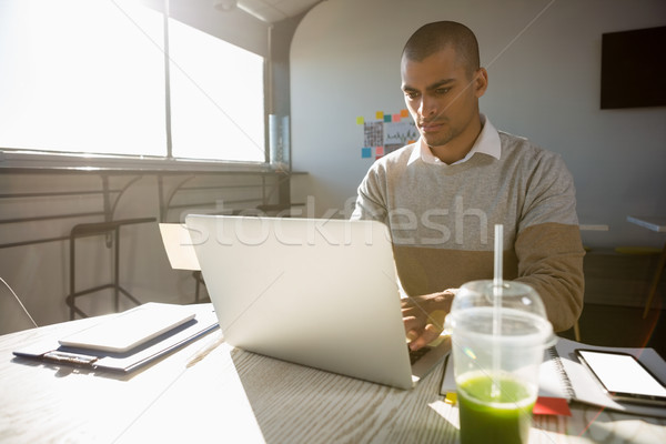 Man working in office on sunny day Stock photo © wavebreak_media