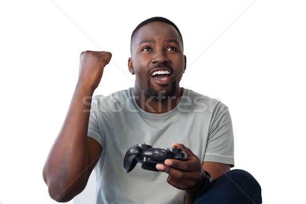 Adam oynama video oyunu beyaz heyecanlı teknoloji Stok fotoğraf © wavebreak_media