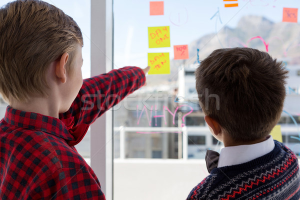 Kids as business executives discussing over whiteboard Stock photo © wavebreak_media