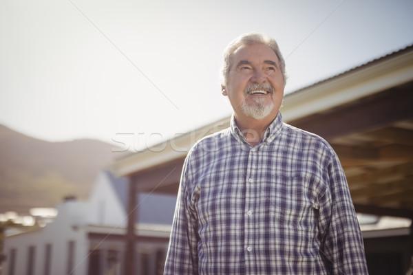 Smiling senior man looking at the sky Stock photo © wavebreak_media