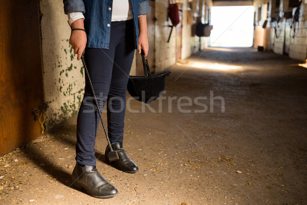 Stock photo: Girl standing in the stable