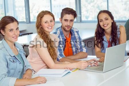 Lezser üzleti csapat megbeszélés laptopot használ tabletta kreatív Stock fotó © wavebreak_media