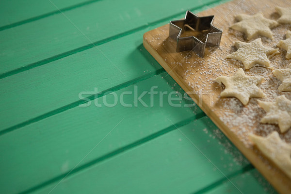 High angle view of star shape cookies on cutting board Stock photo © wavebreak_media