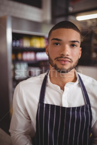 Yakışıklı genç garson kahvehane portre ayakta Stok fotoğraf © wavebreak_media