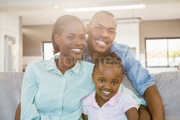 Happy family relaxing on the couch Stock photo © wavebreak_media