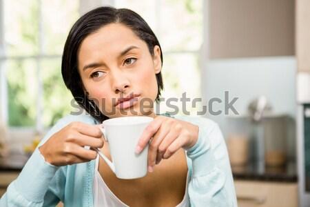 Zdenerwowany brunetka biały kubek kuchnia Zdjęcia stock © wavebreak_media