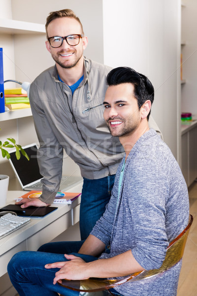 Happy gay couple smiling Stock photo © wavebreak_media