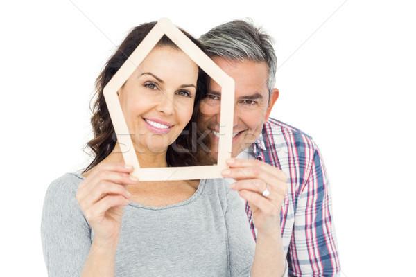 Couple holding house shape Stock photo © wavebreak_media