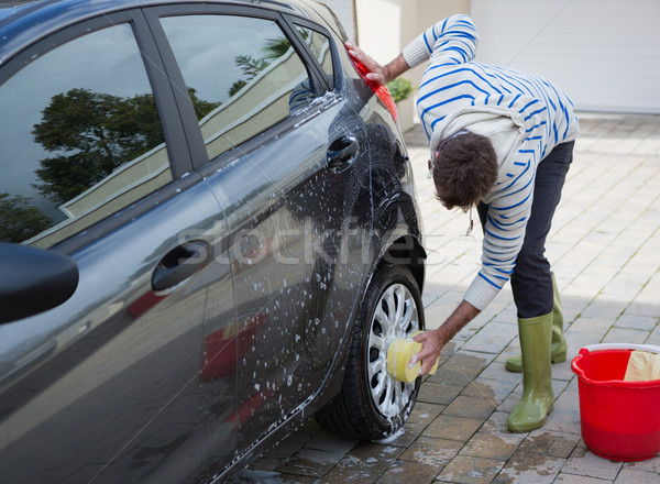 Automático serviço pessoal lavagem carro pneu Foto stock © wavebreak_media